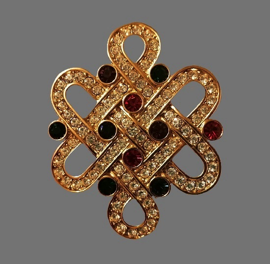 Ornamental gold tone rhinestones brooch. 5.5 cm. 1980s