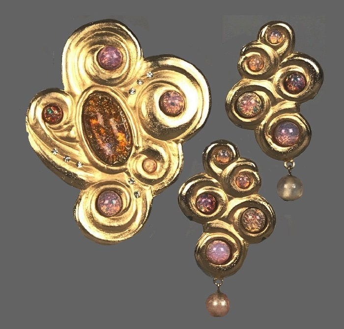 Swirl design brooch and earrings. Gold tone alloy, faux opal cabochons, white rhinestones