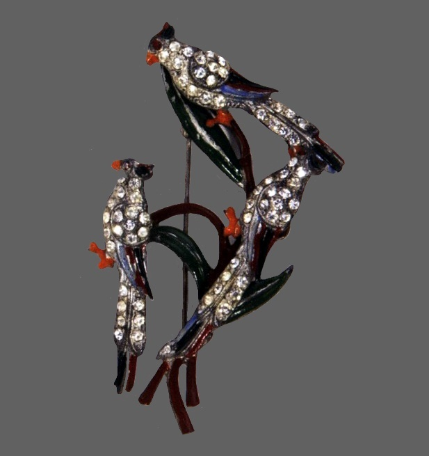 'Trembling Parrots' brooch, 1940. Marked Staret, Manufacturer Staret Jewelry Co., Inc. Pot metal, brown, green, red, orange and blue enamel and rhinestones. 7.5 cm