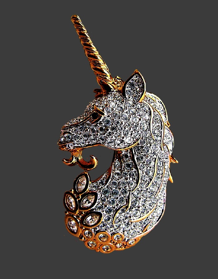 Unicorn vintage brooch. Gold-colored jewelry alloy, rhinestones, Swarovski crystals. 6 cm. Marked with a swan
