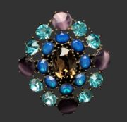 Vintage brooch pendant. Jewelry alloy, crystals, glass cabochons