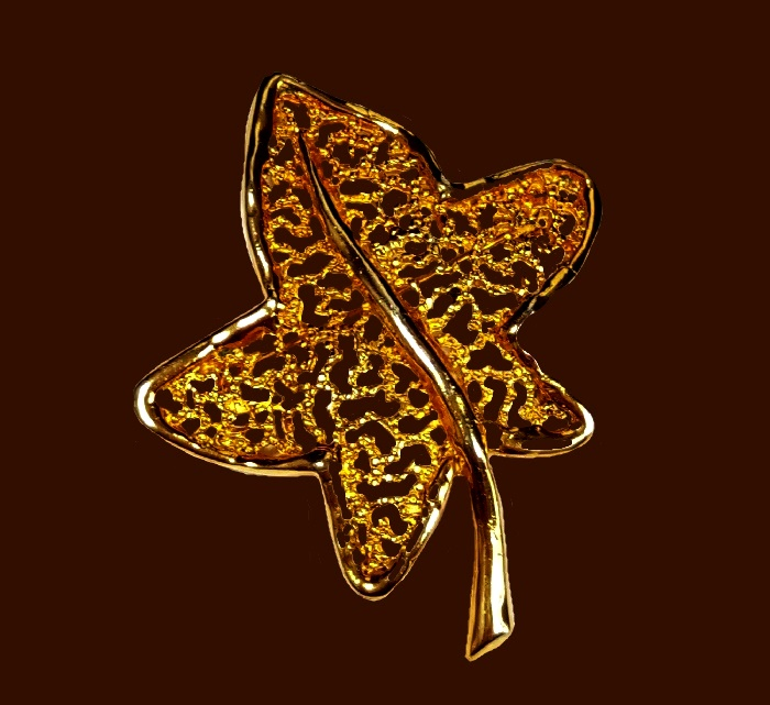 Vintage gold filigree leaf brooch of gold tone