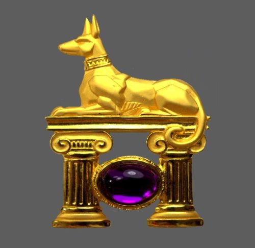 Watch Dog Egyptian style gold tone brooch with large sapphire cabochon