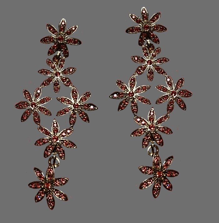 Amazing star flower earrings of silver tone, decorated with crystals and rhinestones