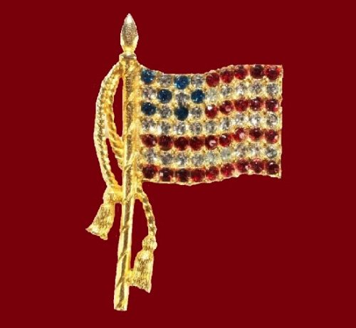 American flag brooch pin. Red and blue rhinestones, jewelry alloy