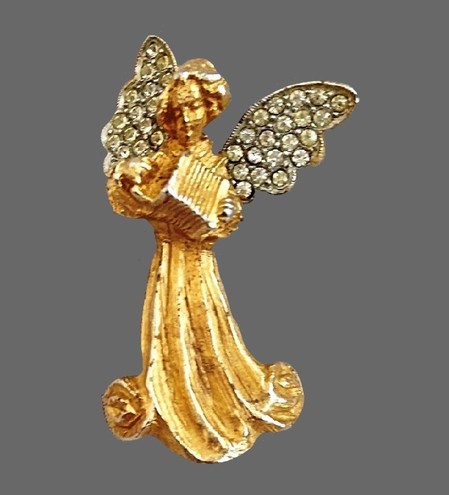 Angel playing accordion brooch. Gold tone jewelry alloy, rhinestones
