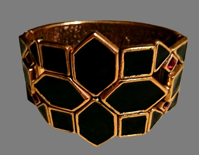 Black and gold geometrical pattern bracelet. Gold tone jewelry alloy, enamel