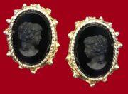 Black cameo earrings. Textured metal of gold tone