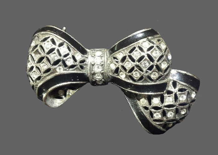 Bow brooch. Clear rhinestones, enamel, jewelry alloy