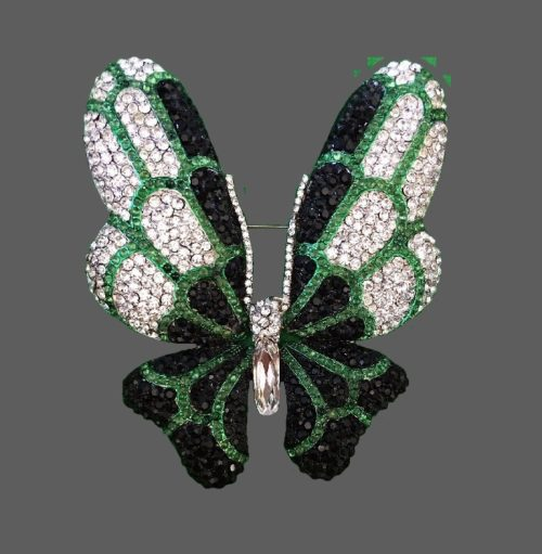Butterfly brooch decorated with clear, black and green crystals