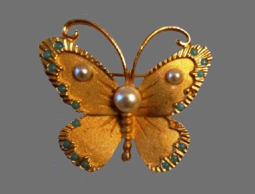 Butterfly gold tone faux pearl brooch