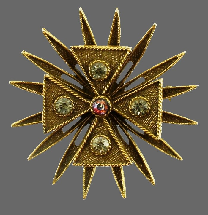 Classic Maltese cross design brooch. Textured gold tone metal, rhinestones