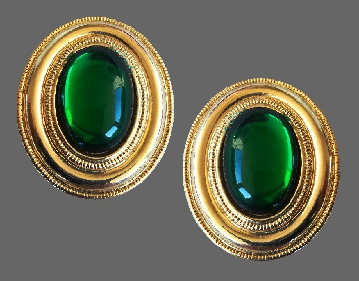 Classic oval gold tone earrings with emerald glass cabochon