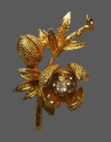 Flower brooch. Gold tone jewelry alloy, rhinestones, crystals