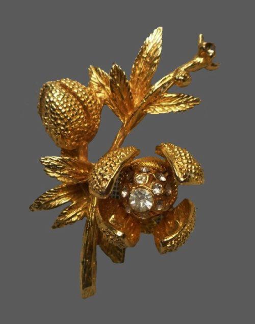 Flower brooch. Gold tone jewelry alloy, rhinestones, crystals
