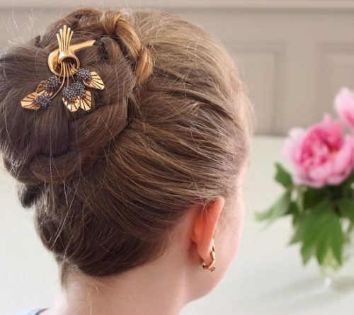 Boucheron blackberry gold brooch as hair ornament