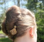 Brooches as hair ornaments. La Chatelaine antique fine jewelry