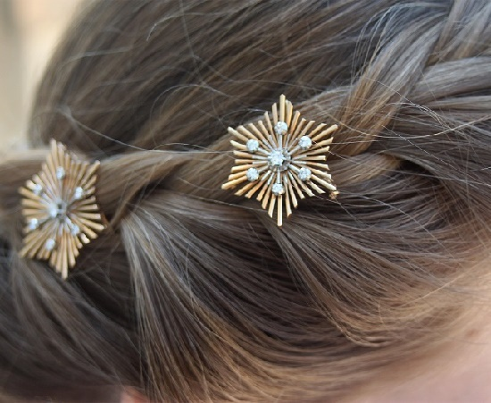 A set of two 18K yellow and white gold diamond snowflake brooches from the 1940s