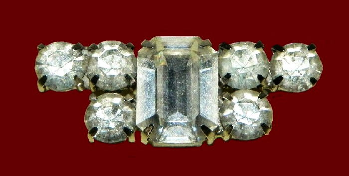 Laconic geometrical design brooch of silver tone with clear rhinestones