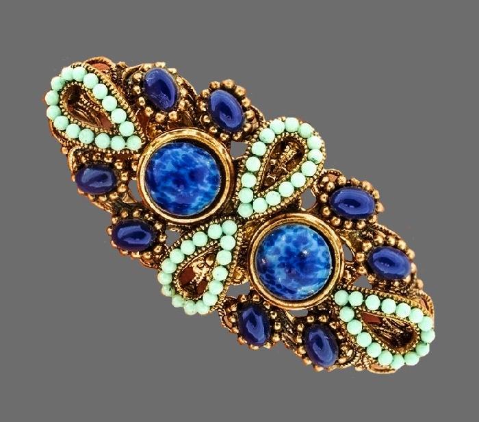 Lapis lazuli brooch. Jewelry alloy of gold tone, blue oval cabochons, turquoise beads. 1960s. 5 cm