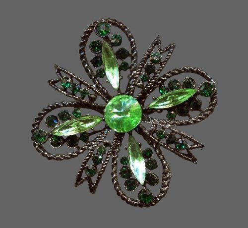 Maltese cross brooch. Silver tone jewelry alloy, rhinestones