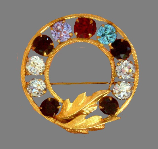 Marked DCE wreath brooch with leaves. 14 K Gold, rhinestones. Curtis costume jewelry