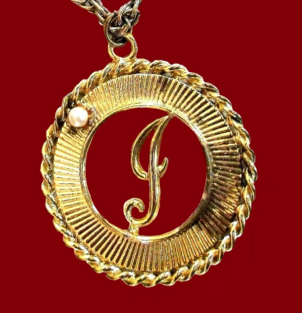 Monogram 'J' pendant. Textured gold tone metal