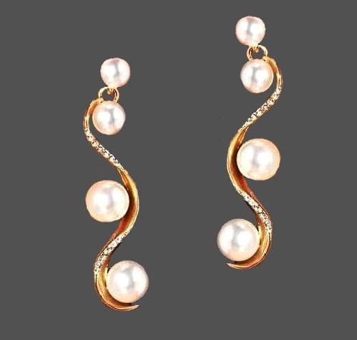 Pearl earrings. Jewelry alloy, crystals, faux pearls