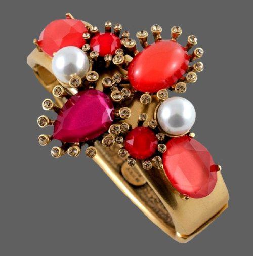Pink bracelet. 5.8 cm. Metal, glass, faux pearls. Width 1.8 cm, decoration 6.5 cm