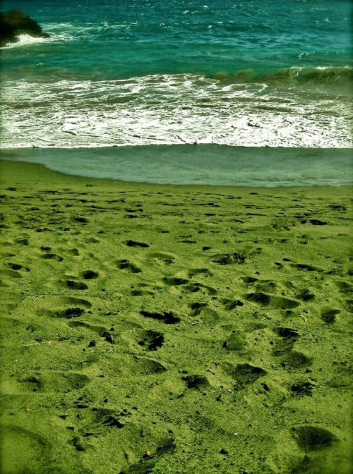 Small pieces of well-rounded chrysolite, or olivine minerals decorate the entire coast in this place, called Papakolea