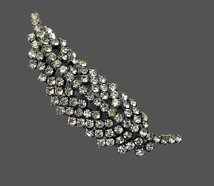 Sparkling feather brooch. Jewelry alloy, rhinestones