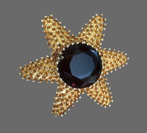 Starfish brooch with large topaz color rhinestone in the middle