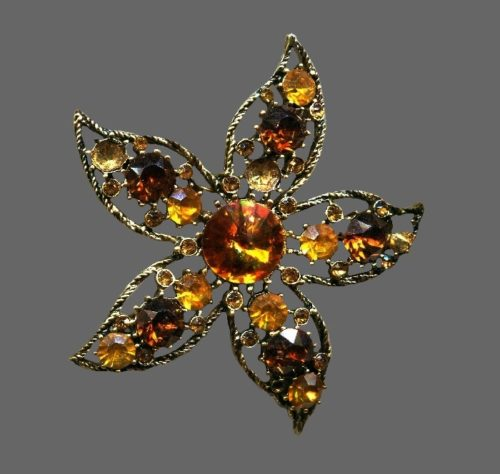 Starfish brooch. Jewelry alloy, amber and topaz rhinestones