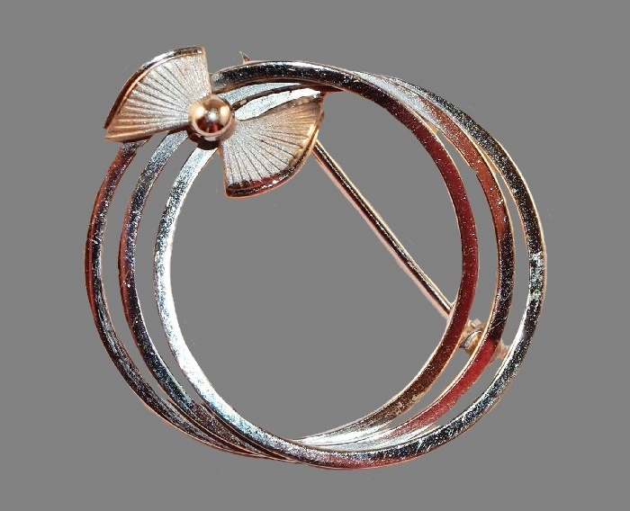 Sterling silver circles with a bow brooch
