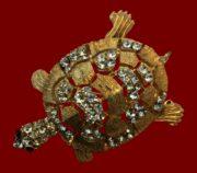 Turtle textured gold tone meta broochl, clear rhinestones