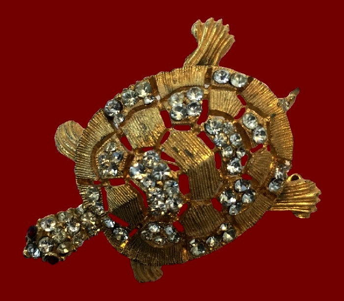 Turtle textured gold tone meta broochl, clear rhinestones