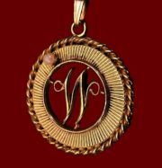 'W' initial pendant. Gold tone textured alloy, 1958