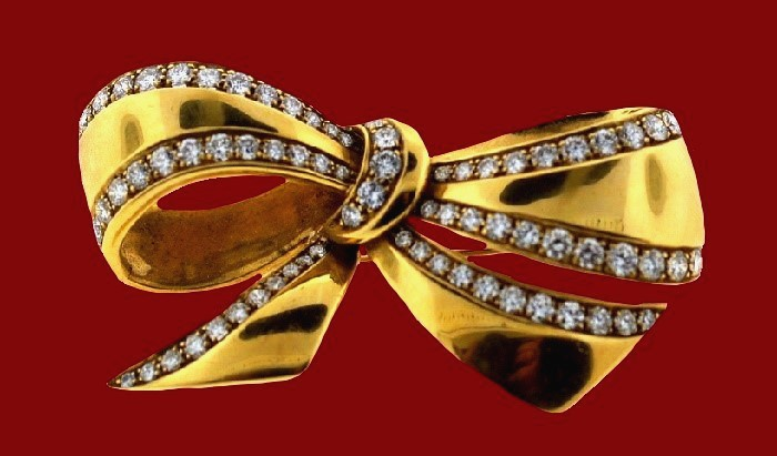Yellow gold and diamond bow brooch