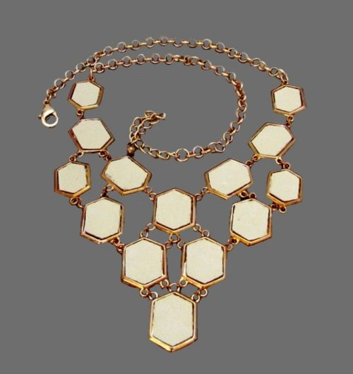1980's necklace, golden tone metal, inserts of the ivory color leather. Length 48 cm