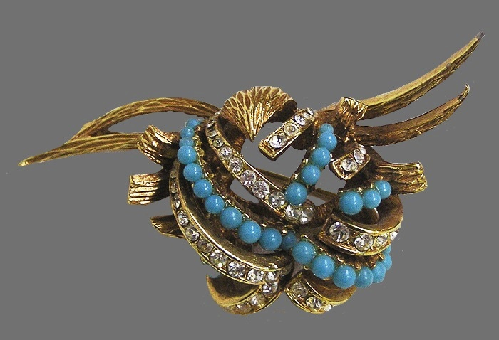 Abstract design brooch. Gold tone jewelry alloy, rhinestones, faux turquoise beads