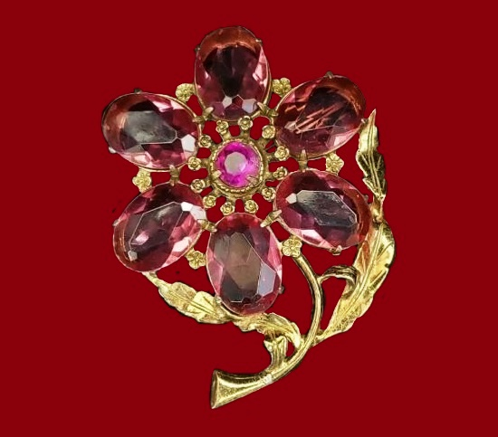 Amethyst glass cabochon flower brooch of gold tone