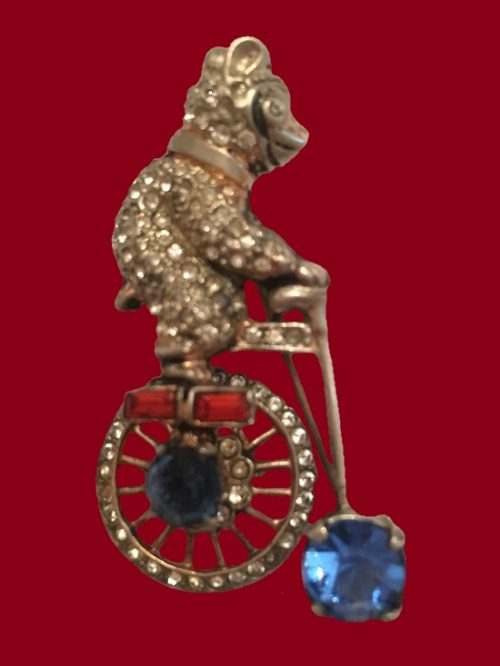 Bear on a bicycle. Sterling silver, rhinestones. 5.5 cm
