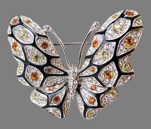 Beautiful butterfly brooch by Nolan Miller. 6.3 cm. Rhodium plated, enamel, Swarovski crystals