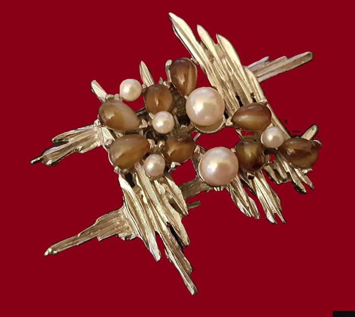 Beautiful gold tone brooch of abstract design. Jewelry alloy, faux pearls, glass cabochons