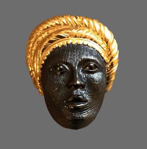 Blackamoor woman vintage brooch pin of gold tone. 1980s