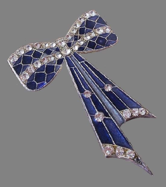 Bow brooch. Silver tone filigree metal, enamel, Swarovski crystals. 7 cm