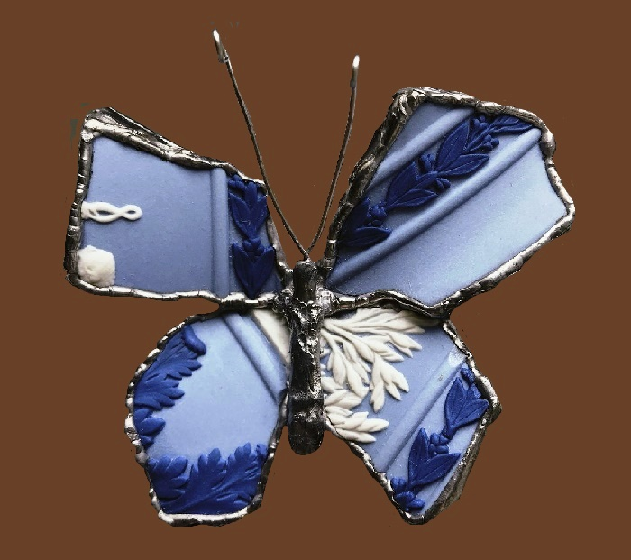 Butterfly brooch of porcelain pieces by Wedgwood. Biscuit porcelain, tin, jasper porcelain. 7 cm