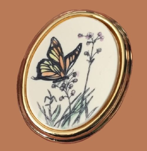 Butterfly on grass oval pin. 3.5 cm