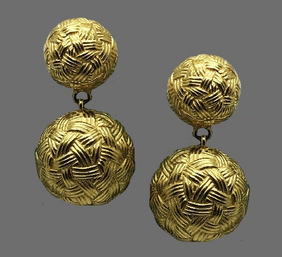 Button shape dangling earrings. Gold tone textured metal