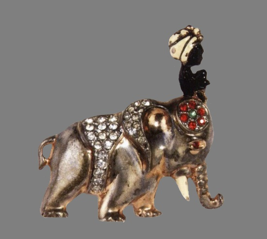 Elephant with cornack. 1947. Gold-plated sterling brooch with black and white enamel, red and green rhinestones